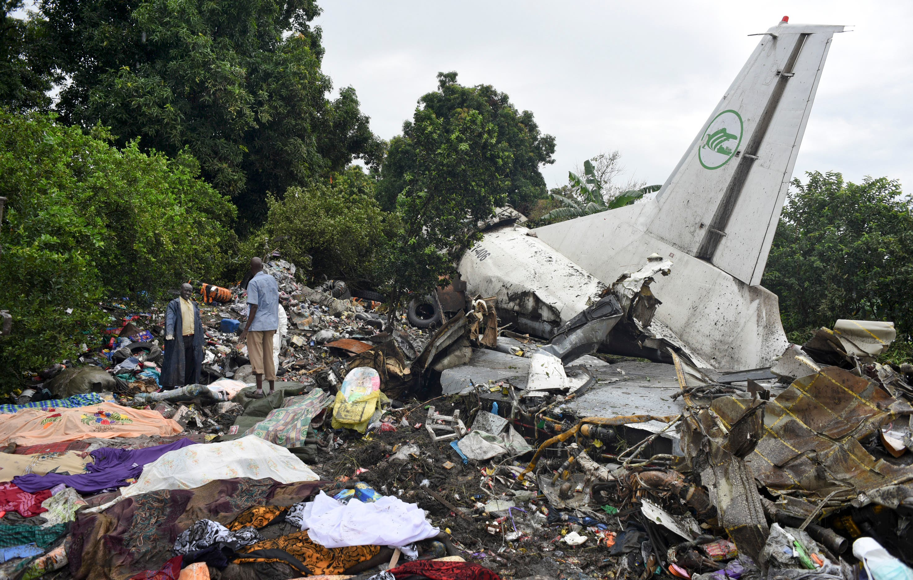 Responders pick through the wreckage of a cargo plane which crashed in the capital Juba, South Sudan Wednesday, Nov. 4, 2015. (AP)