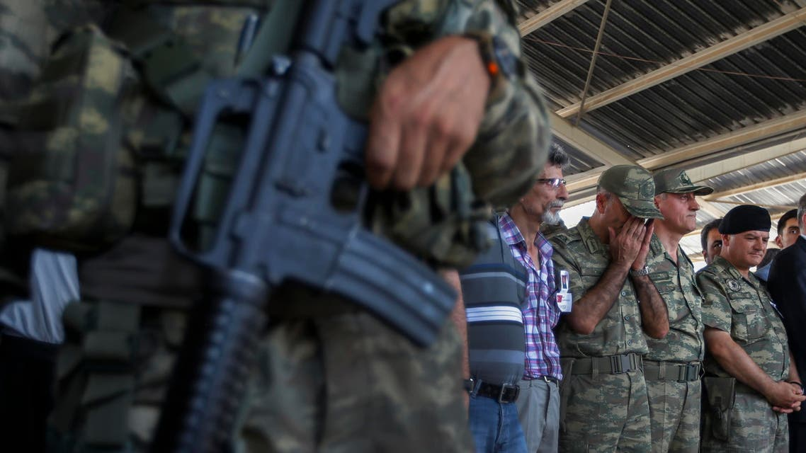 Turkish soldiers pray during the funeral of slain soldier Mehmet Yalcin Nane, killed Thursday by IS militants when they attacked a Turkish military outpost at the border with Syria, in the town of Gaziantep, southeastern Turkey, Friday, July 24, 2015. Turkish warplanes struck Islamic State group targets across the border in Syria early Friday, government officials said, a day after IS militants fired at a Turkish military outpost, killing Nane. The bombing is a strong tactical shift for Turkey which had long been reluctant to join the U.S.-led coalition against the extremist group. (AP Photo/Emrah Gurel)