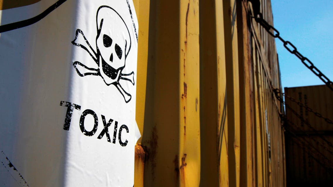 "In this photo taken on Tuesday, May 13, 2014, a sticker reading ""Toxic"" on containers carrying Syria's dangerous chemical weapons AP"