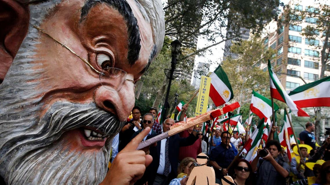 A protester wearing a large mask bearing the likeness of Iranian President Hassan Rouhani attends an anti-Rouhani rally outside United Nations headquarters ahead of the leader's address to the 70th session of the U.N. General Assembly. (AP)