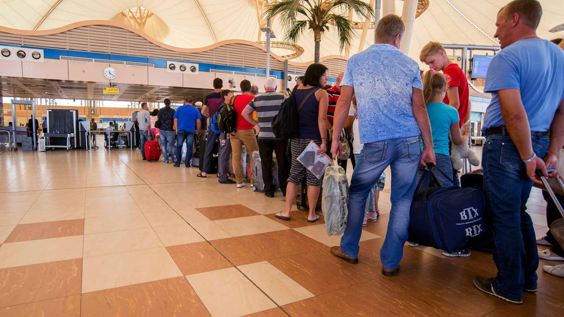 In this Saturday, Oct. 31, 2015 file photo, passengers line up to depart from Sharm el-Sheikh Airport hours after a Russian aircraft carrying 224 people, including 17 children, crashed about 20 minutes after taking off from Sharm el-Sheikh. (AP)