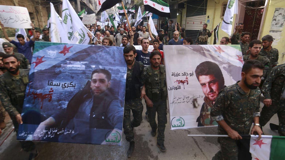 Free Syrian Army fighters and residents carry pictures of Free Syrian Army commander Abu Khaled Aziza (R) and fighter Bakri Sakka, who both died fighting Islamic state fighters in the northern countryside of Aleppo, during a march to mourn their deaths in Aleppo, Syria October 16, 2015. REUTERS/Hosam KatanFOR EDITORIAL USE ONLY. NO RESALES. NO ARCHIVE.