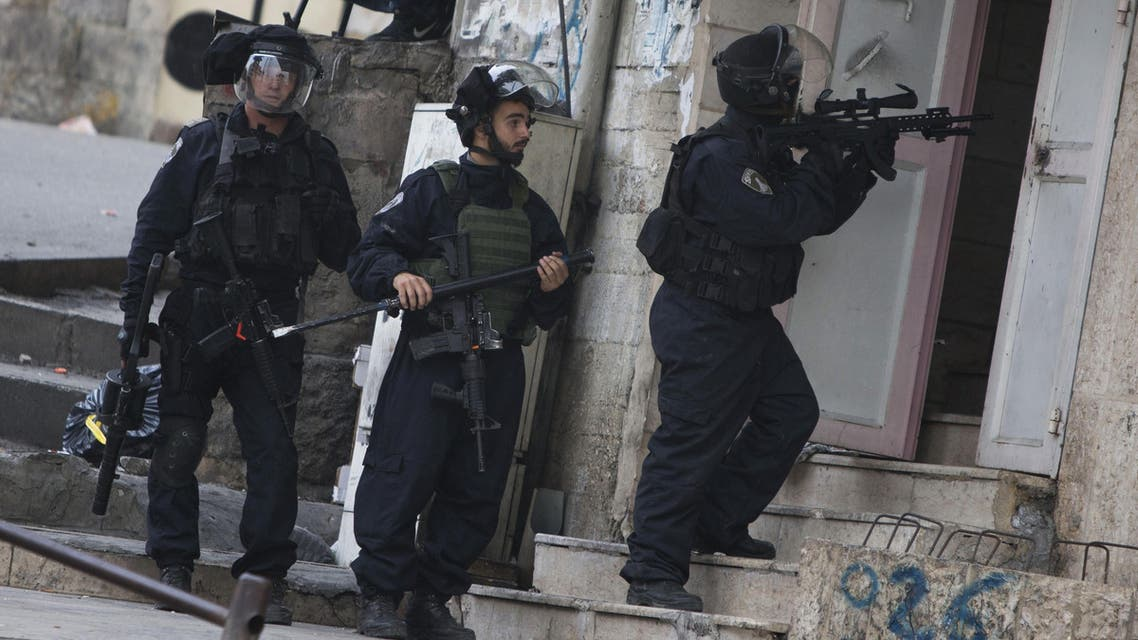 An Israeli border policeman enters a shop during clashes with Palestinian demonstrators following a funeral of Ibrahim Skafi, 22, in the West Bank city of Hebron, Thursday, Nov. 5, 2015. AP