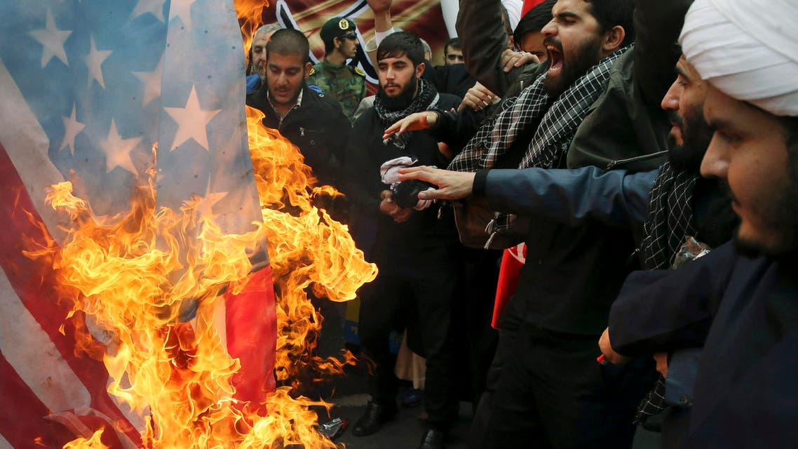 Iranian demonstrators burn a representation of the U.S. flag during an annual rally in front of the former U.S. Embassy in Tehran, marking 36th anniversary of the seizure of the embassy by militant Iranian students, Iran, Wednesday, Oct. 4, 2015.  (AP)