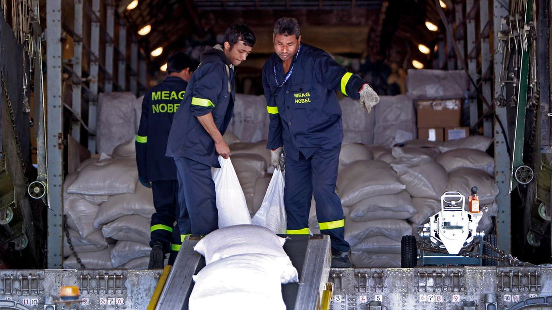 Workers unload emergency aid sent from Russia, at the Rafik Hariri International Airport in Beirut, Lebanon, Wednesday, April 3, 2013. AO
