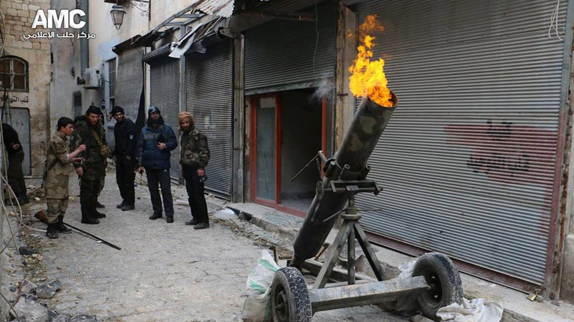 Syrian rebels firing locally made shells against the Syrian government forces, in Aleppo, Syria.  AP