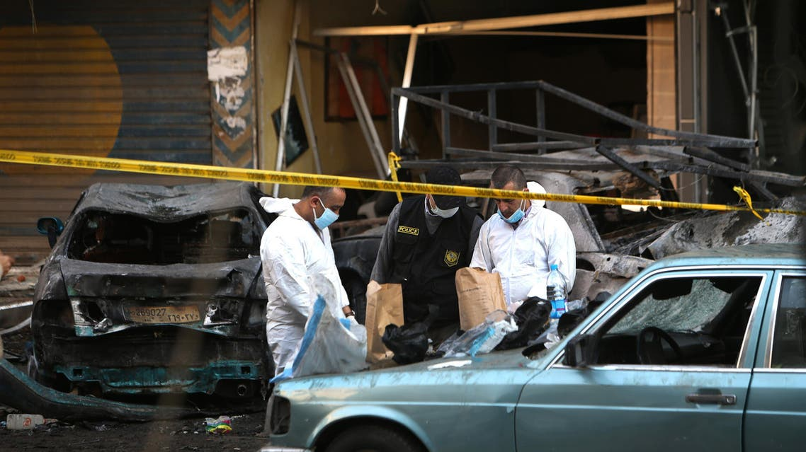 Lebanese army investigators work at the site of an explosion in a southern suburb of Beirut, Lebanon, Tuesday, Jan. 21, 2014. AP