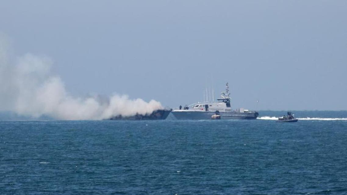 Picture shows an Egyptian naval vessel approaching another army boat on fire on the maritime border between Egypt and the Palestinian Gaza Strip, off the coast of Rafah. (AFP)