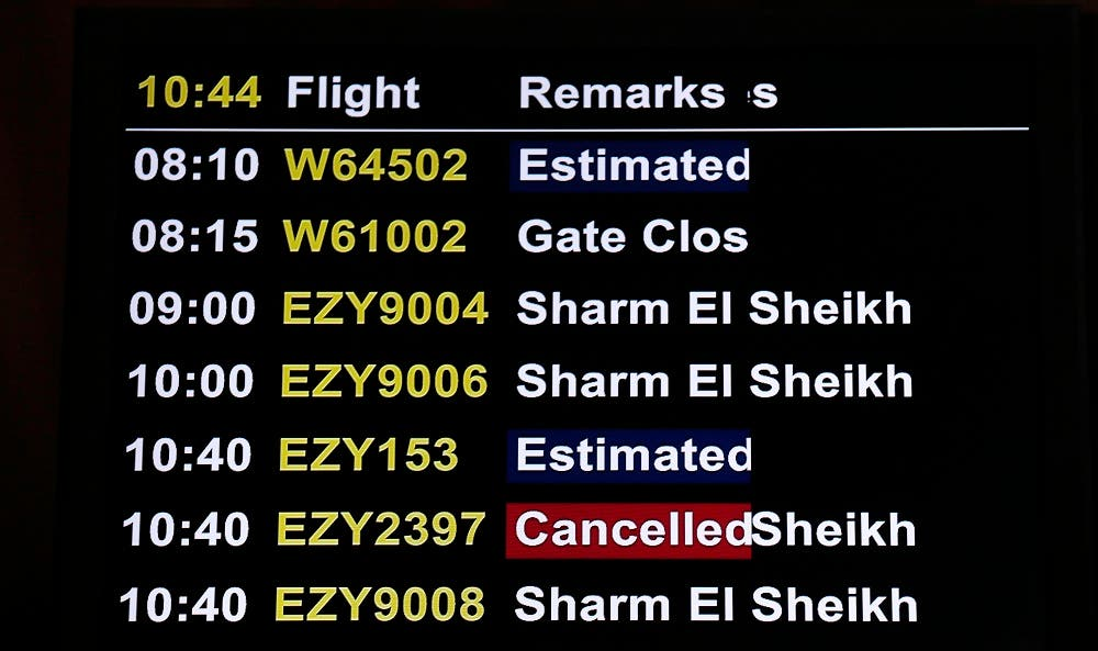 A flight departures board displays a cancelled flight to Sharm al-Sheik at Luton Airport, in Luton, Britain November 6, 2015. (Reuters)
