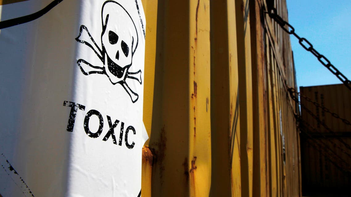 """In this photo taken on Tuesday, May 13, 2014, a sticker reading """"Toxic"""" on containers carrying Syria's dangerous chemical weapons, on the Danish cargo ship, Ark Futura, transporting the chemical weapons out of the strife-torn country, in Cyprus coastal waters. AP"""