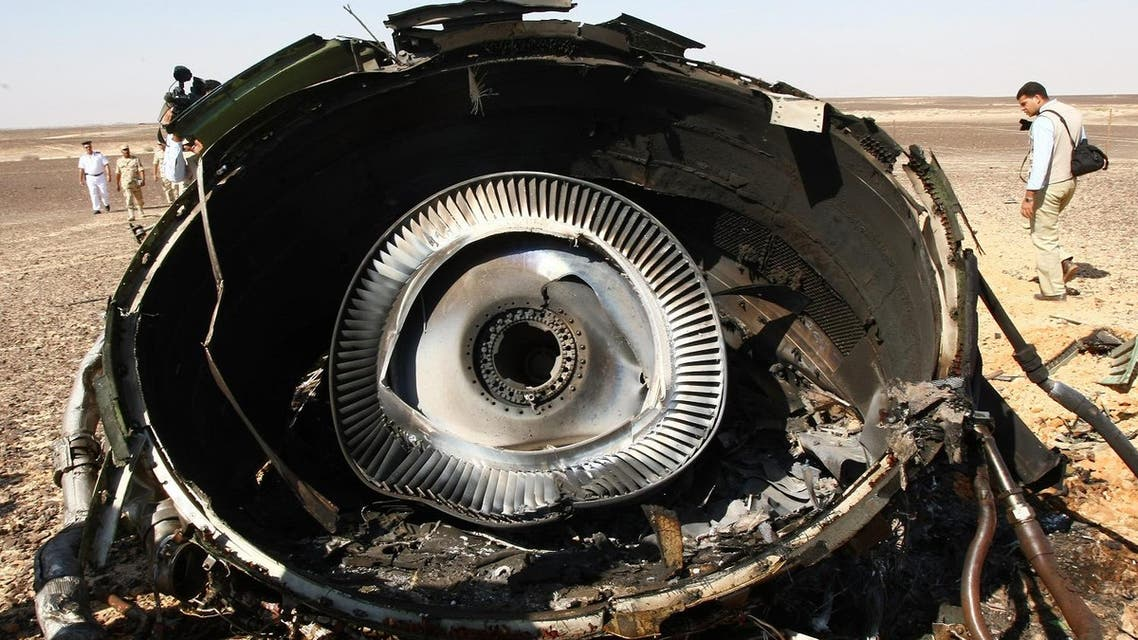 In this photo made available Monday, Nov. 2, 2015, and provided by Russian Emergency Situations Ministry, Egyptian Military experts examine a piece of an engine at the wreckage of a passenger jet bound for St. Petersburg in Russia that crashed in Hassana, Egypt. (AP)