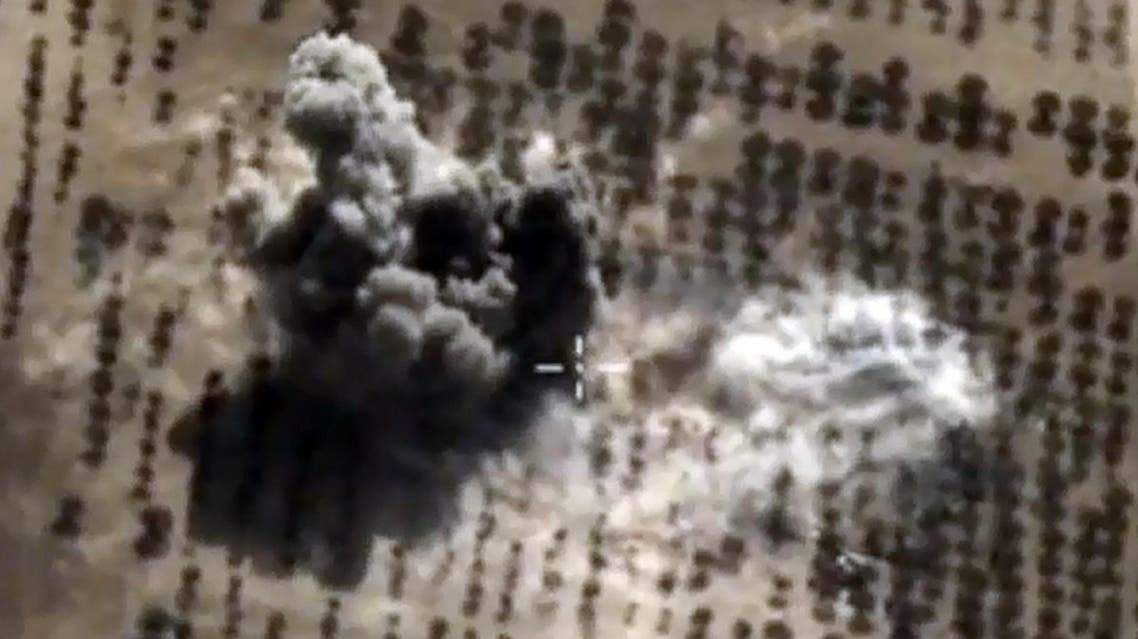 A video grab from October 15, 2015 shows an image taken from footage on the Russian Defence Ministry's official website, purporting to show an explosion after airstrikes carried out by Russian air force in the Syrian province of Idlib. (AFP)