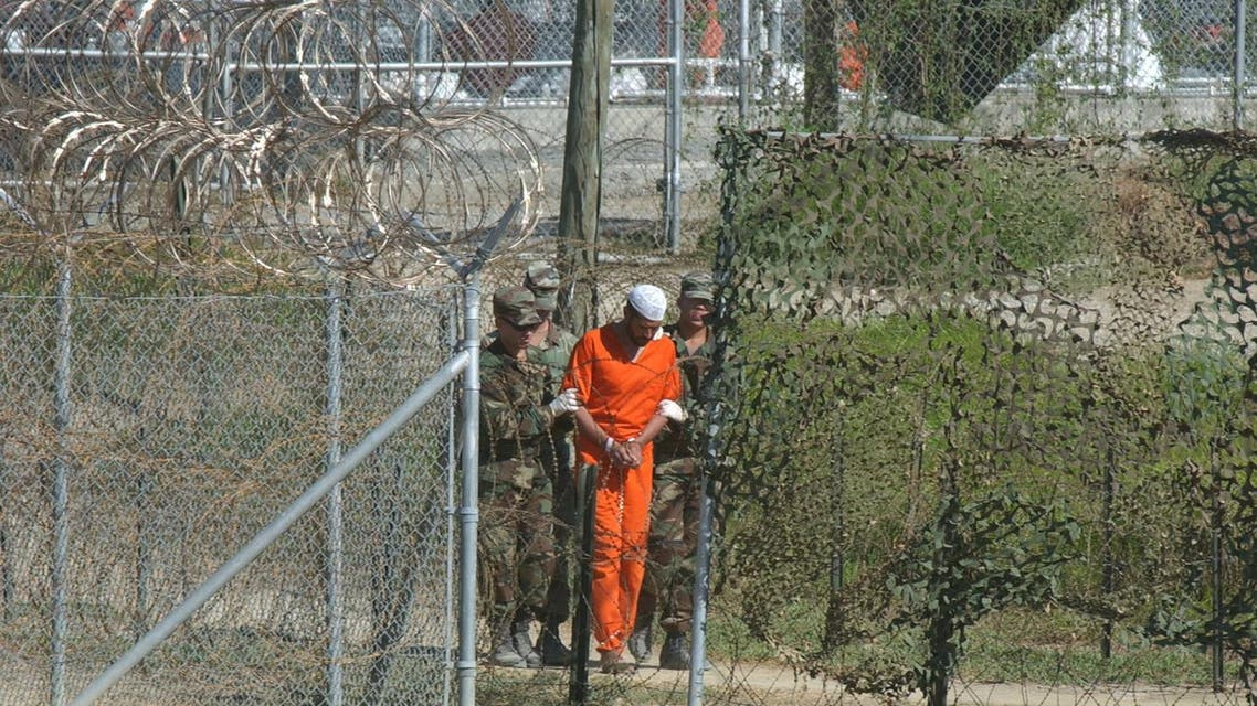 In this March 1, 2002 file photo, a detainee is escorted to interrogation by U.S. military guards at Camp X-Ray at Guantanamo Bay U.S. Naval Base, Cuba. Three detainees from Guantanamo Bay have been transferred from the island prison to the country of Georgia. (AP)