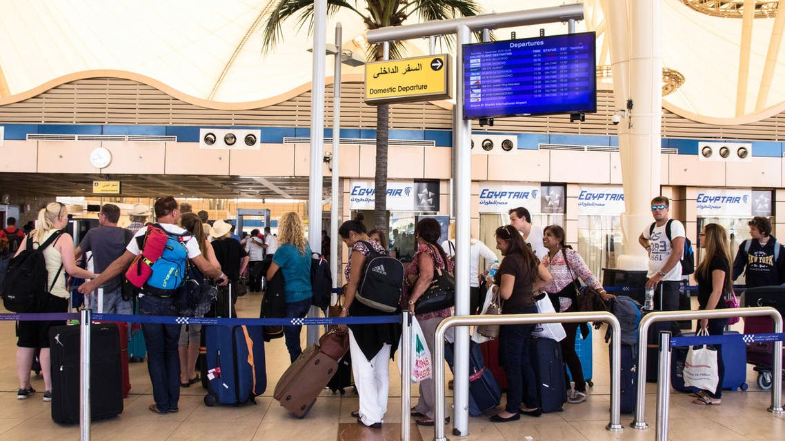 British tourists line up for luggage screening at the airport of Sharm el-Sheikh, Egypt, on Saturday, Nov. 7, 2015. ?AP