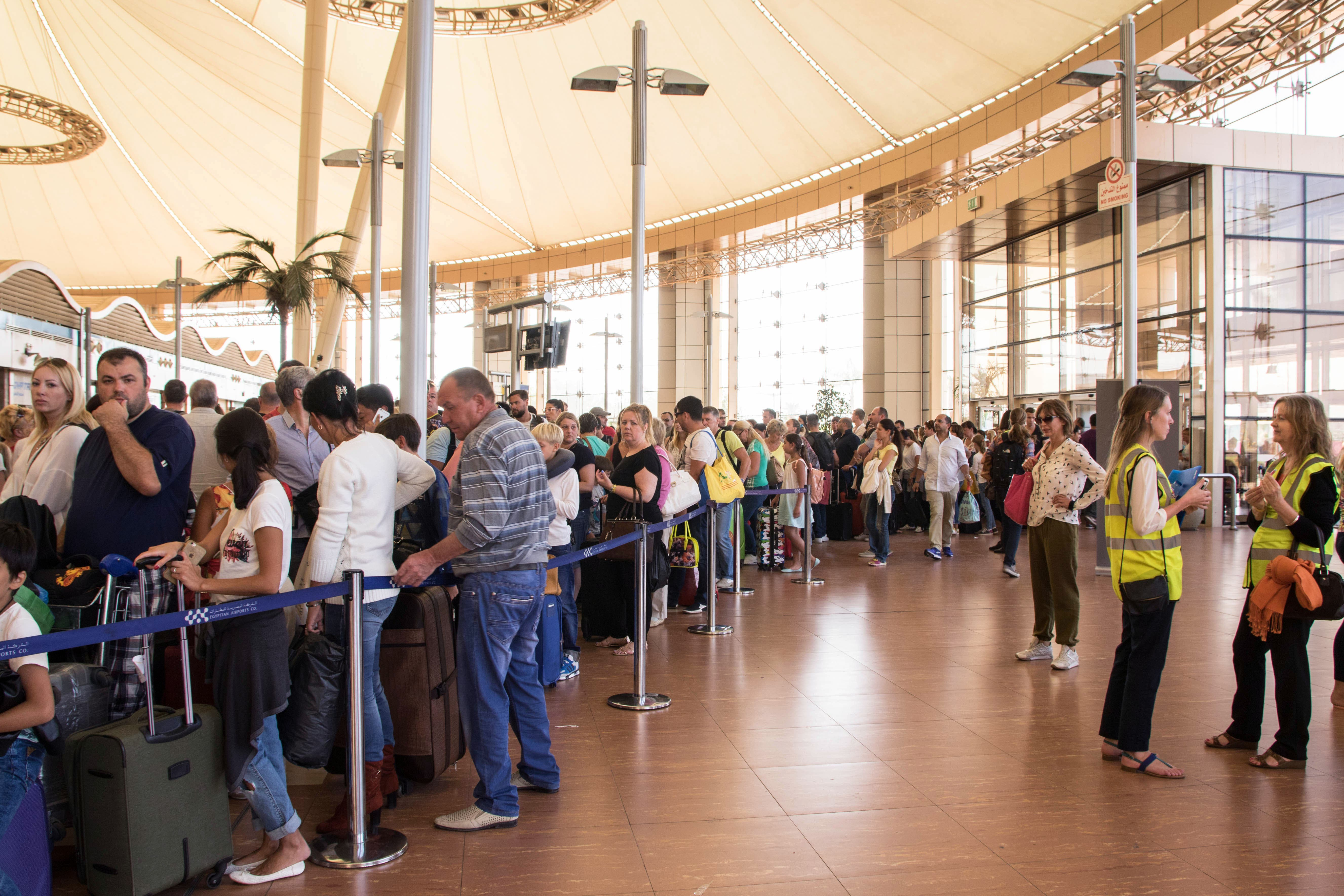 Tourists line up for luggage screening at the airport of Sharm el-Sheikh, Egypt, on Saturday, Nov. 7, 2015. London approved the resumption of British flights to Sinai starting Friday and planned a wave of flights to retrieve its stranded nationals, but it banned passengers from checking luggage on the flights. Instead, any checked-in bags were to be brought later on cargo planes. (AP Photo/Vinciane Jacquet)