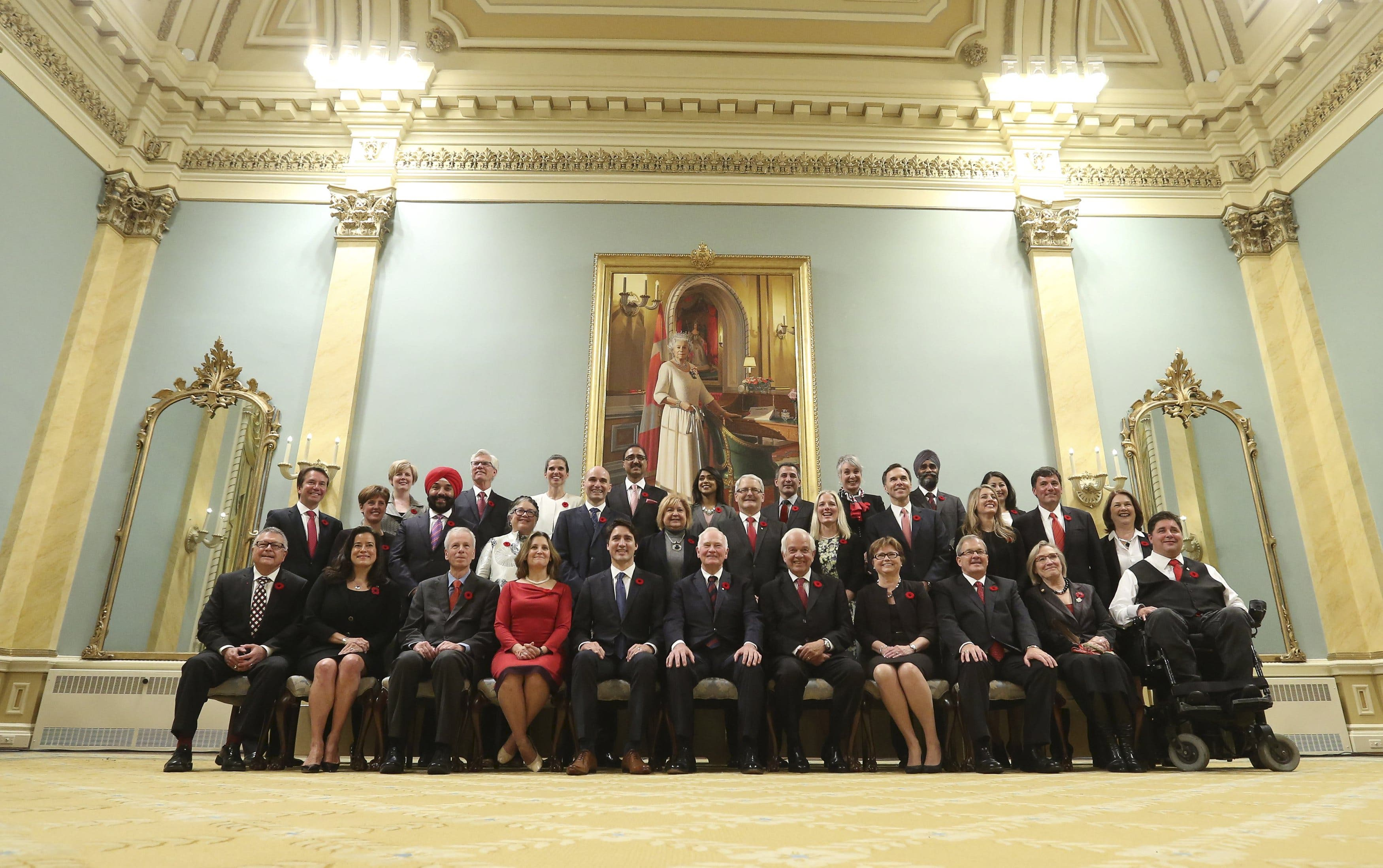 Canada's new PM Trudeau poses with his cabinet after their swearing-in ceremony at Rideau Hall in Ottawa. (Reuters)