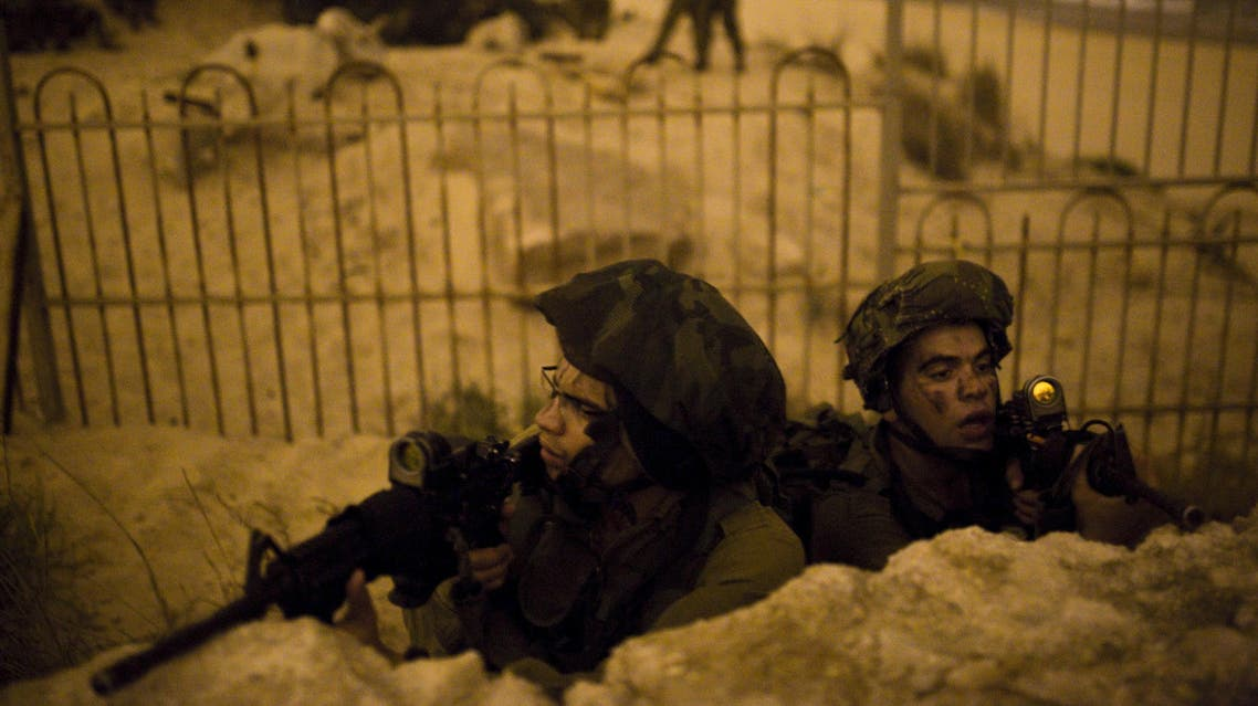Israeli soldiers take part in a night-time drill on the shore of the Mediterranean sea near the southern city of Ashdod November 5, 2015. (Reuters)