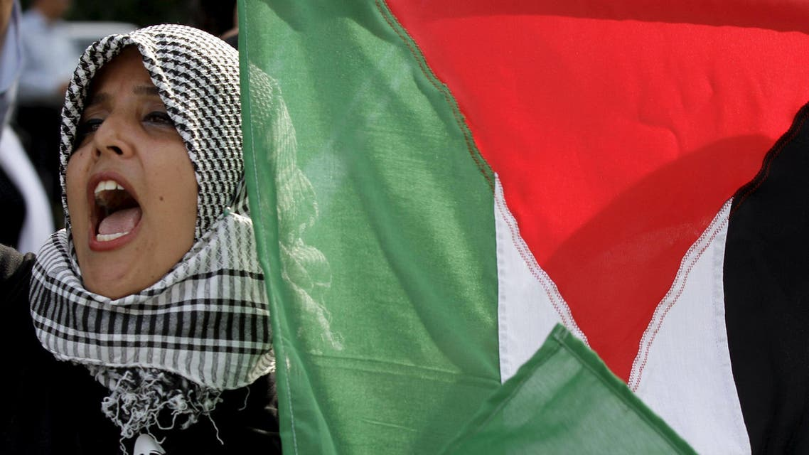 Woman holds a Palestinian flag and shouts slogans during a demonstration in solidarity with the Palestinian people at Avenue Habib Bourguiba in Tunis, Tunisia. (File: Reuters)
