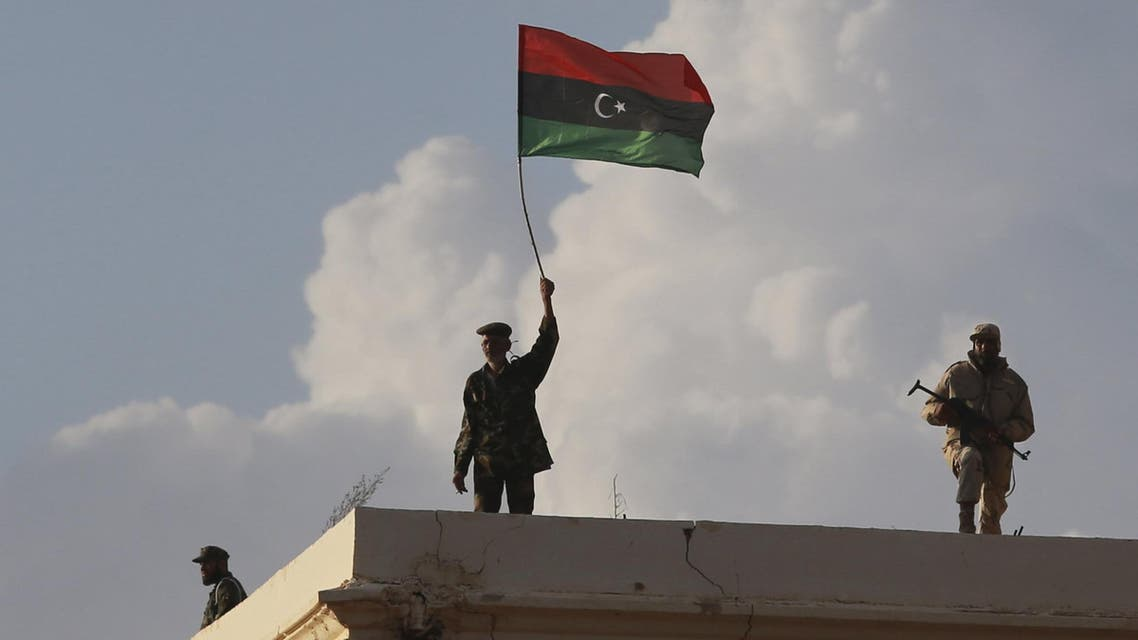 Members of the military stand guard as people protest against candidates for a national unity government proposed by U.N. envoy for Libya Bernardino Leon, in Benghazi