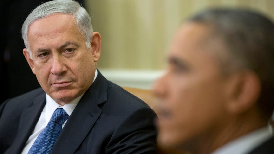 FILE - In this Oct. 1, 2014 file photo, Israeli Prime Minister Benjamin Netanyahu listens as President Barack Obama speaks during their meeting in the Oval Office of the White House in Washington. In recent months, many in the Middle East had assumed — some in hope, others with concern — that once the Iranian nuclear issue was resolved, the United States would make another push for peace between Israel and the Palestinians. With the odds of success slim and U.S. elections approaching, President Barack Obama seems more interested in repairing his tattered relationship with Israel, leaving the Palestinian issue to his successor. (AP Photo/Pablo Martinez Monsivais, File)