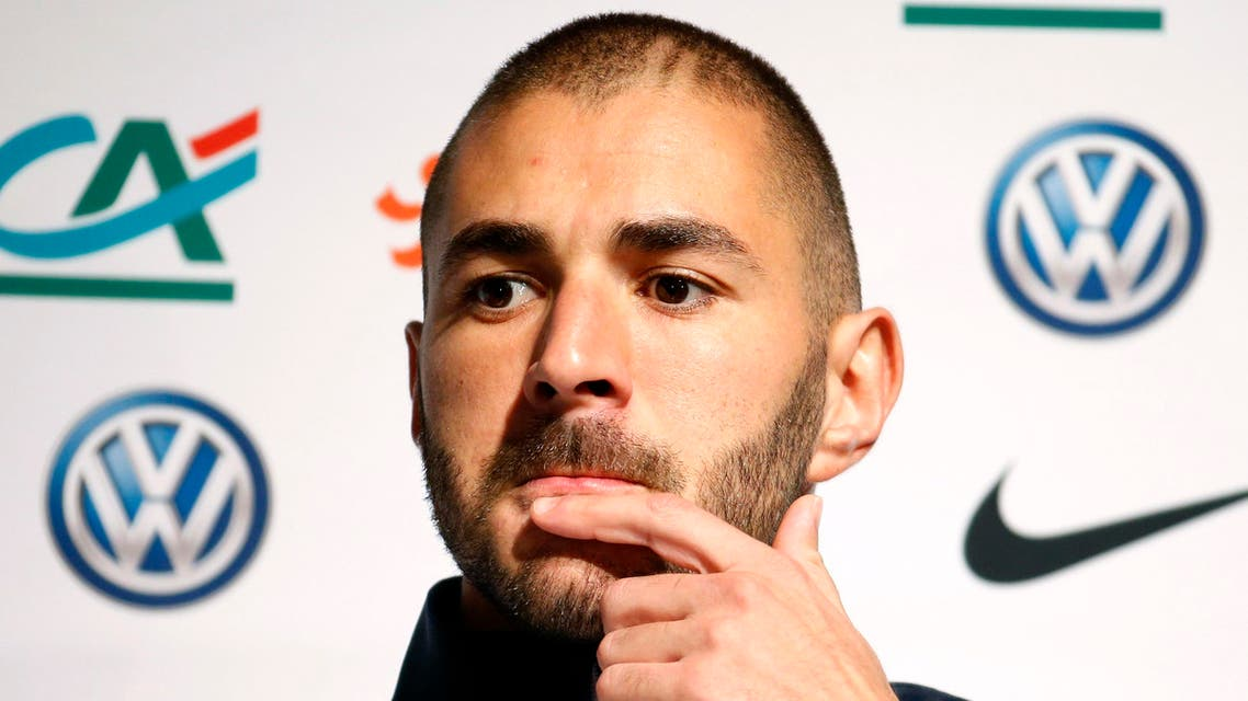 France's national soccer team player Karim Benzema attends a news conference in Clairefontaine, near Paris, in this October 7, 2014 file photo. France soccer International and Real Madrid striker Karim Benzema was placed under formal investigation by a French court in connection with an inquiry into an alleged attempt to blackmail fellow-France soccer international Mathieu Valbuena according to French media. Picture taken October 7, 2014. REUTERS/Charles Platiau/Files TPX IMAGES OF THE DAY