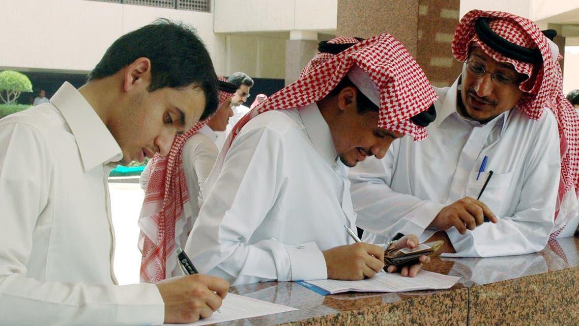 Saudi Employees|AP