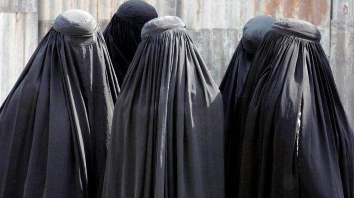 Locals alerted police after noticing that a burqa-clad 'woman' talking on the phone was wearing men's shoes. PHOTO: REUTERS/FILE