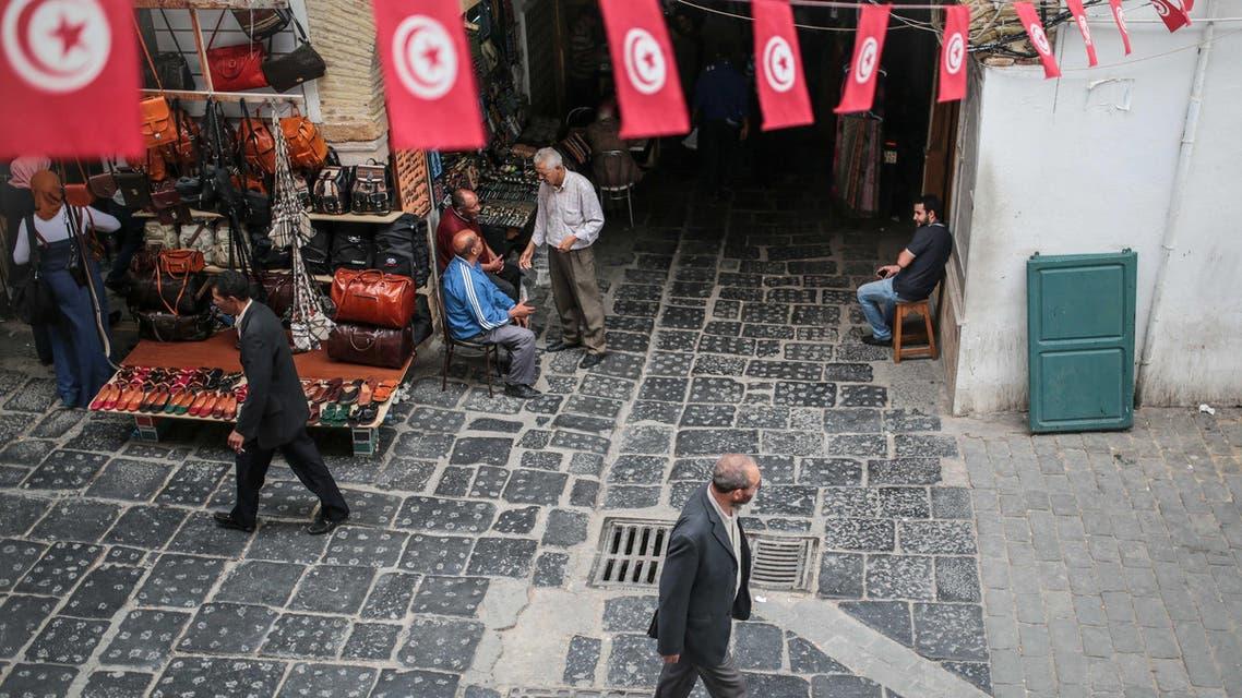 People walk through the Medina market in Tunis, Tunisia, Monday, Oct. 26, 2015. (AP)