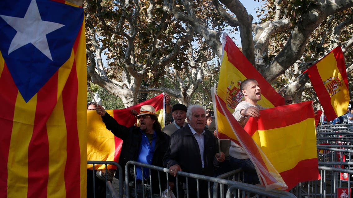 """People hold Spanish flags next to an """"estelada"""" or pro-independence flag, outside parliament in Barcelona, Spain, Monday, Nov. 9, 2015. AP"""