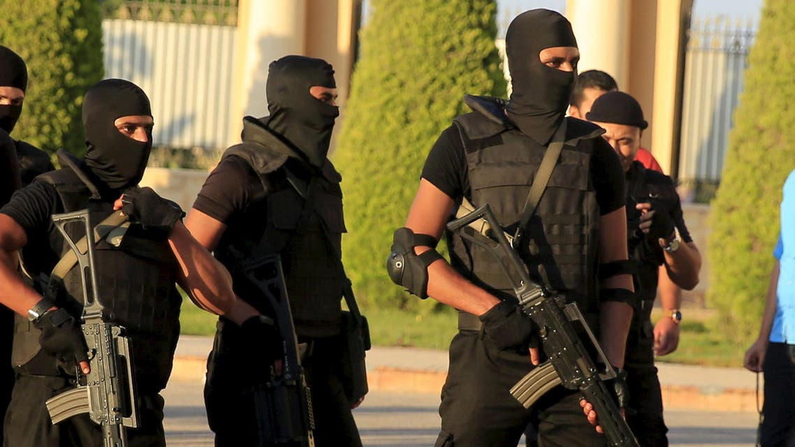 Egyptian special forces police stand in front a stadium Alexandria, Egypt, July 21, 2015