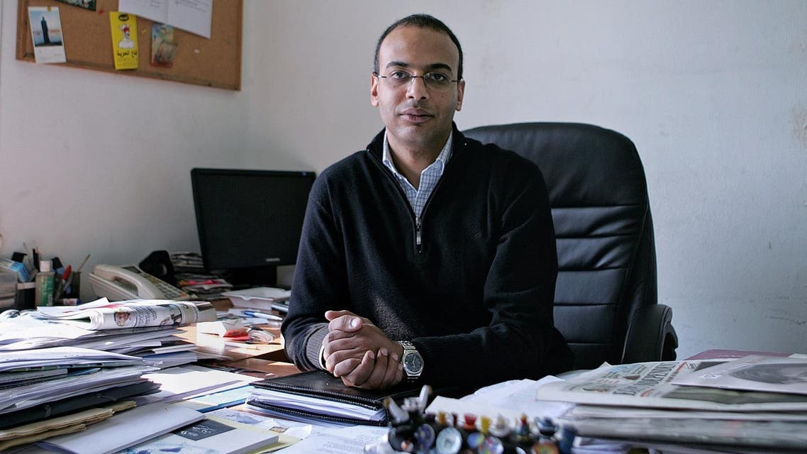 This Dec. 7, 2011 photo, shows Hossam Bahgat in his office at the Egyptian Initiative for Personal Rights in Garden City, Cairo, Egypt. (