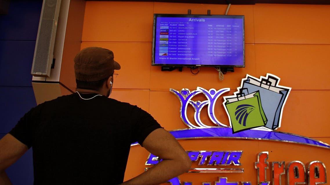 A passenger checks the information board at Sharm el-Sheikh Airport in south Sinai, Egypt, Monday, Nov. 9, 2015. AP