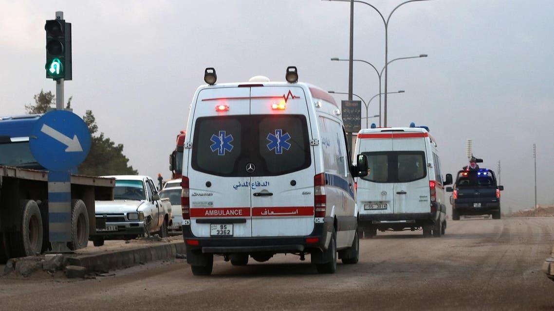 Ambulances leave the King Abdullah bin Al Hussein Training Center where a Jordanian policeman went on a shooting spree in Mwaqar on the outskirts of Amman, Jordan. (AP)