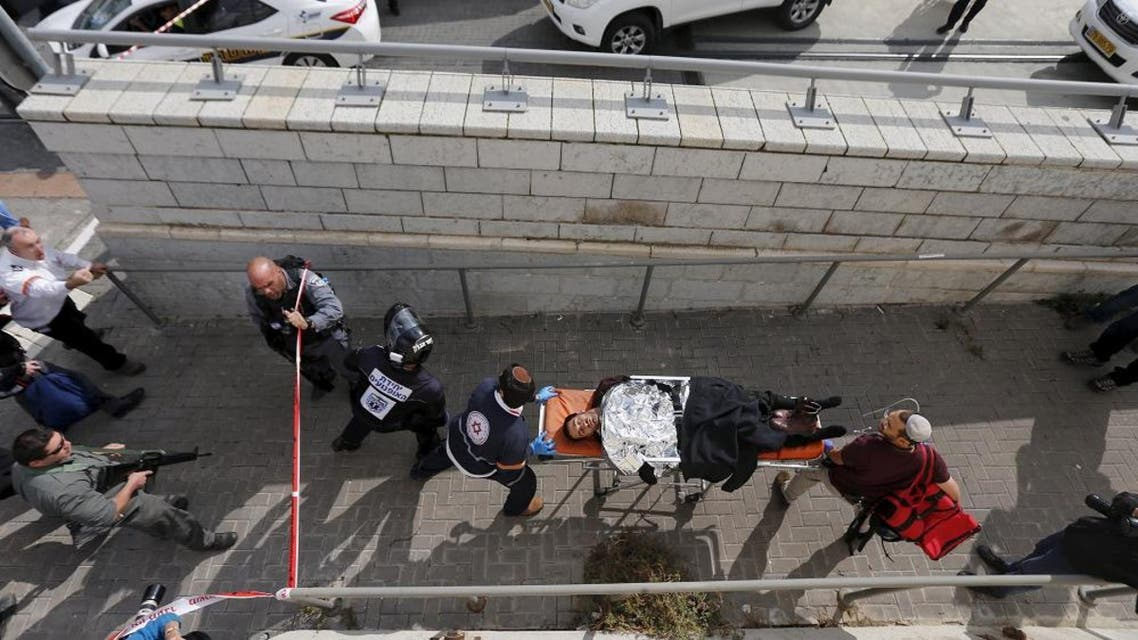 Israeli medics evacuate a wounded Israeli from the scene of a stabbing in Pisgat Zeev, which lies on occupied land that Israel annexed to Jerusalem after the 1967 Middle East war. (Reuters)