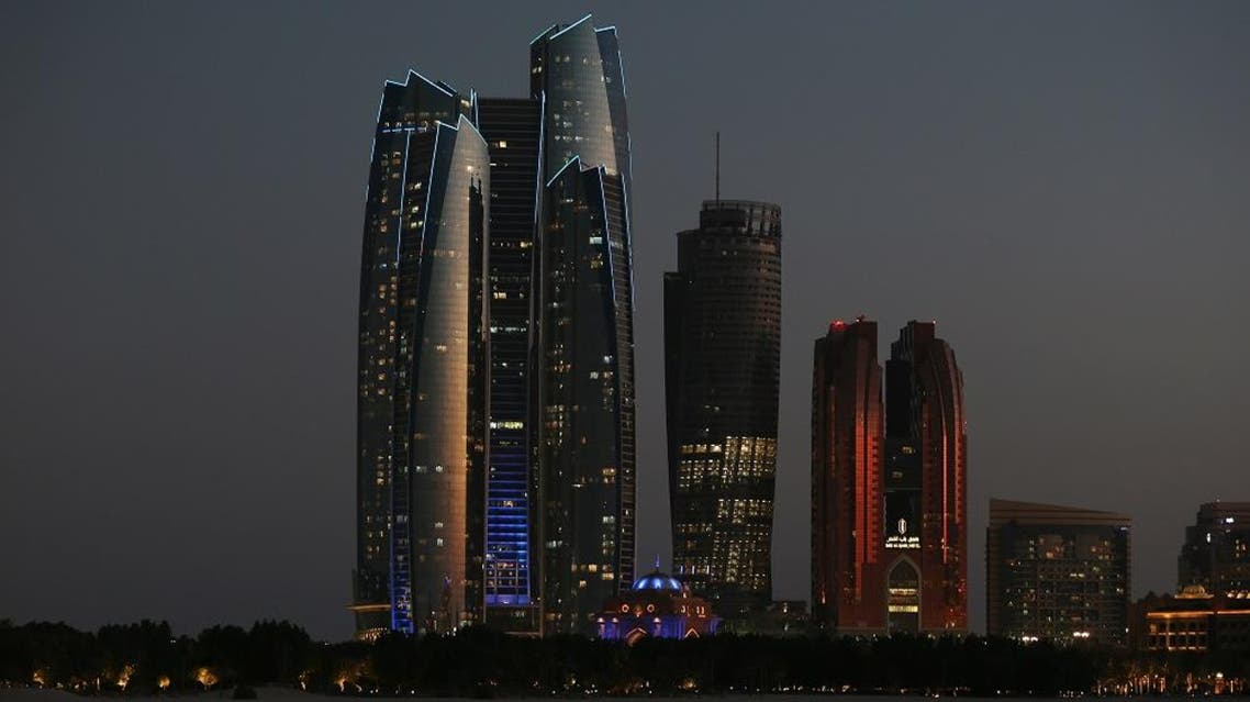 The Etihad Towers, left, are lit in the blue hues of the United Nation's logo in celebration of the U.N.'s 70th anniversary, in Abu Dhabi, United Arab Emirates, Oct. 24, 2015. (AP)
