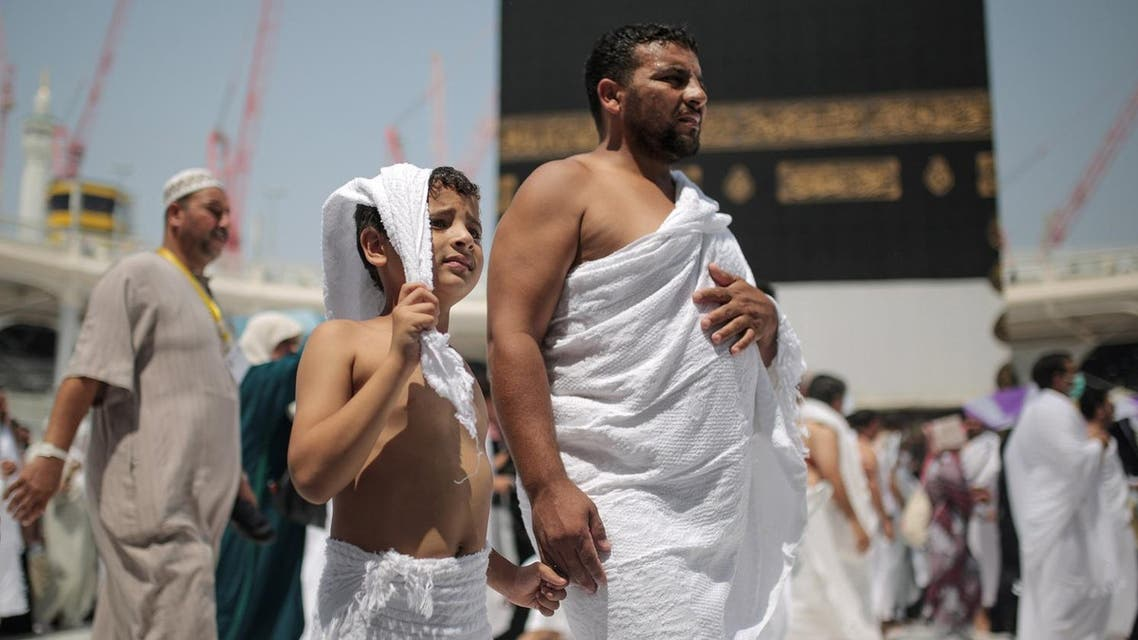 A father and his son circle the Kaaba, the cubic building at the Grand Mosque in the Muslim holy city of Makkah, Saudi Arabia. (File photo: AP)