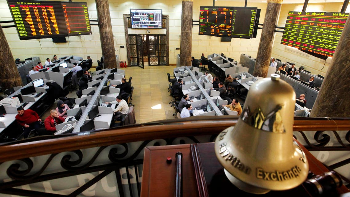 In this Saturday, March 10, 2013 file photo, Egyptian traders work on the floor of the stock market in Cairo, Egypt. AP