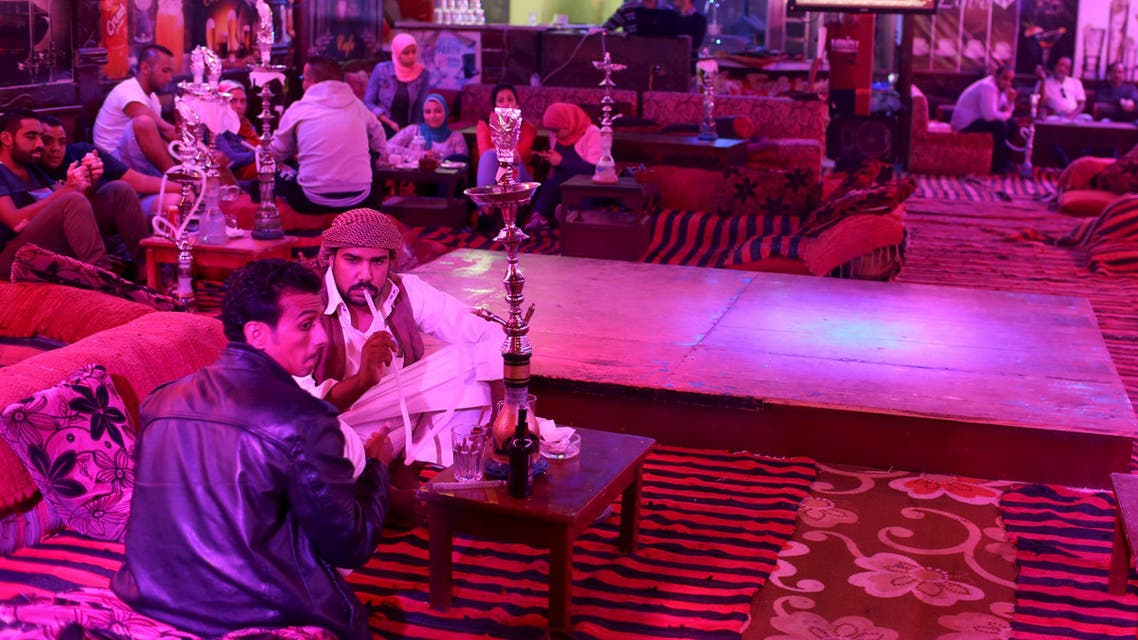 Bedouins and Egyptian tourists sit at a cafe in the Red Sea resort of Sharm el-Sheikh