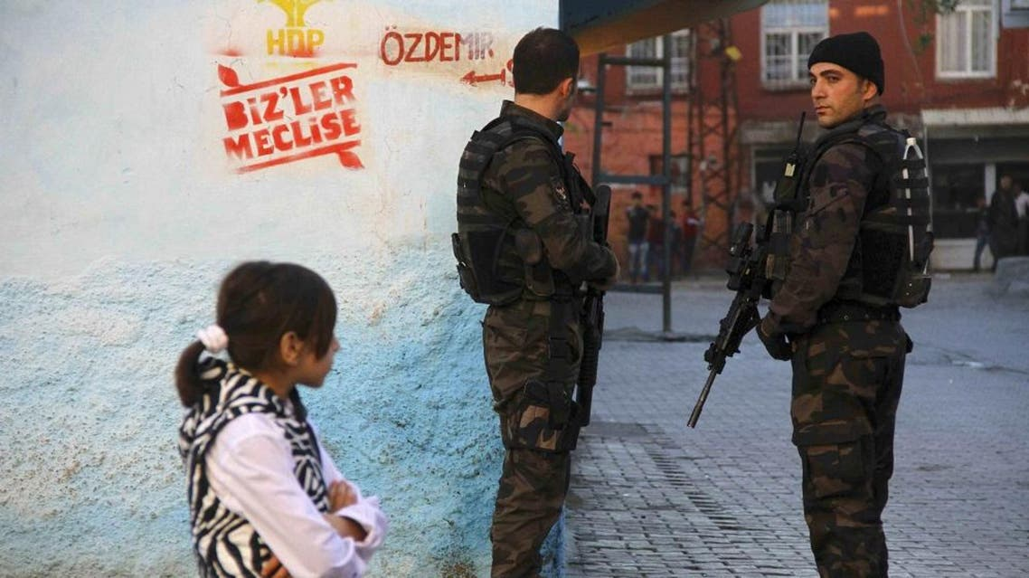 Members of the Turkish police special forces stand guard near a polling station during the parliamentary electin in Diyarbakir, Turkey. (File: Reuters)
