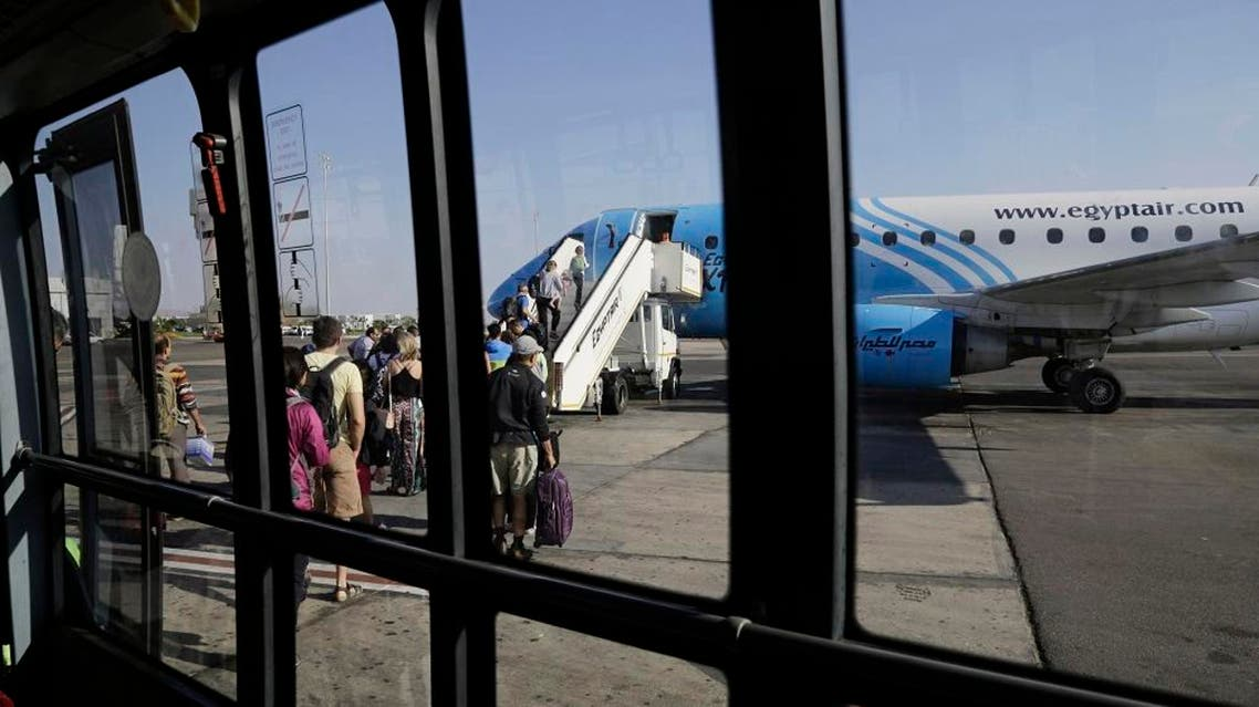 Passengers board an Egyptair Express plane bound for Cairo at Sharm el-Sheikh Airport, south Sinai, Egypt, Monday, Nov. 9, 2015. AP