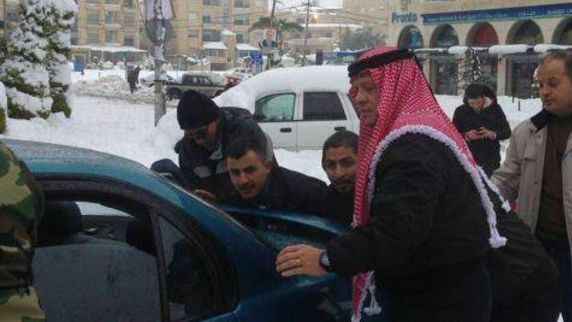Jordan's King Abdullah II helped a group of men push a man's car after it got stuck in the snow in Amman in 2013. (via Twitter)