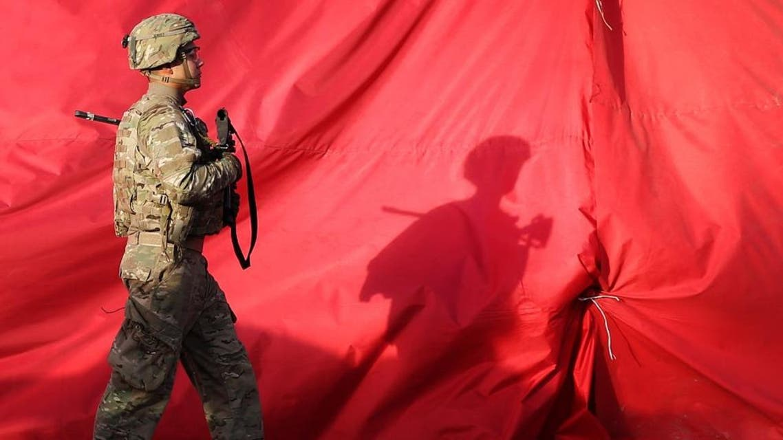 A U.S. soldier walks towards the site of a suicide attack in the heart of Kabul, Afghanistan. (File photo: Reuters)