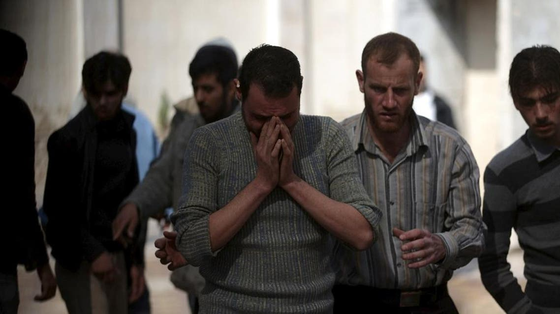 A man reacts as he mourns the death of his relative after missiles were fired by Syrian government forces on a busy marketplace in the Douma neighborhood of Damascus. (File: Reuters)