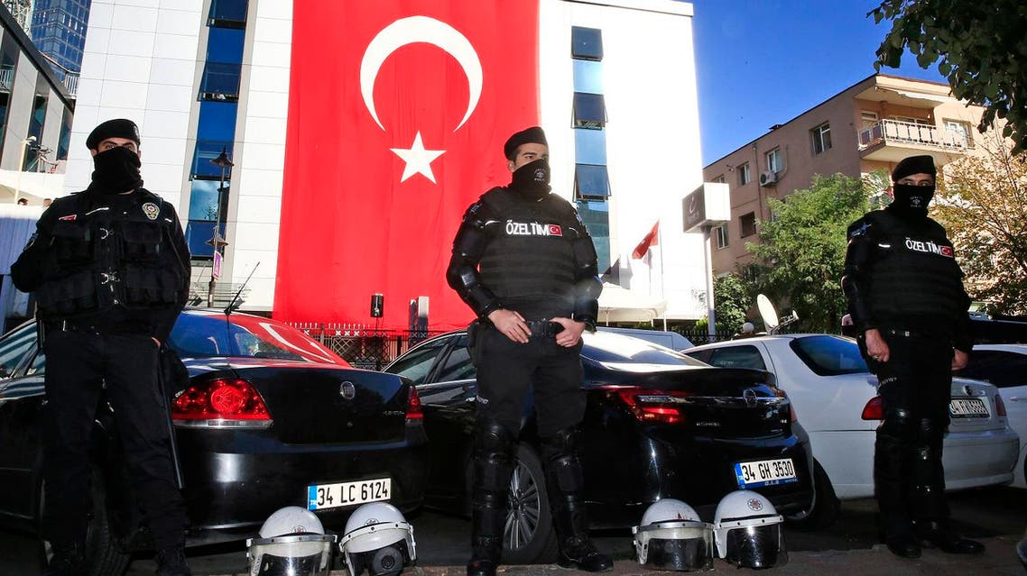 Turkish police officers secure the area around the headquarters of a media company with alleged links to a government critic. (File photo: AP)