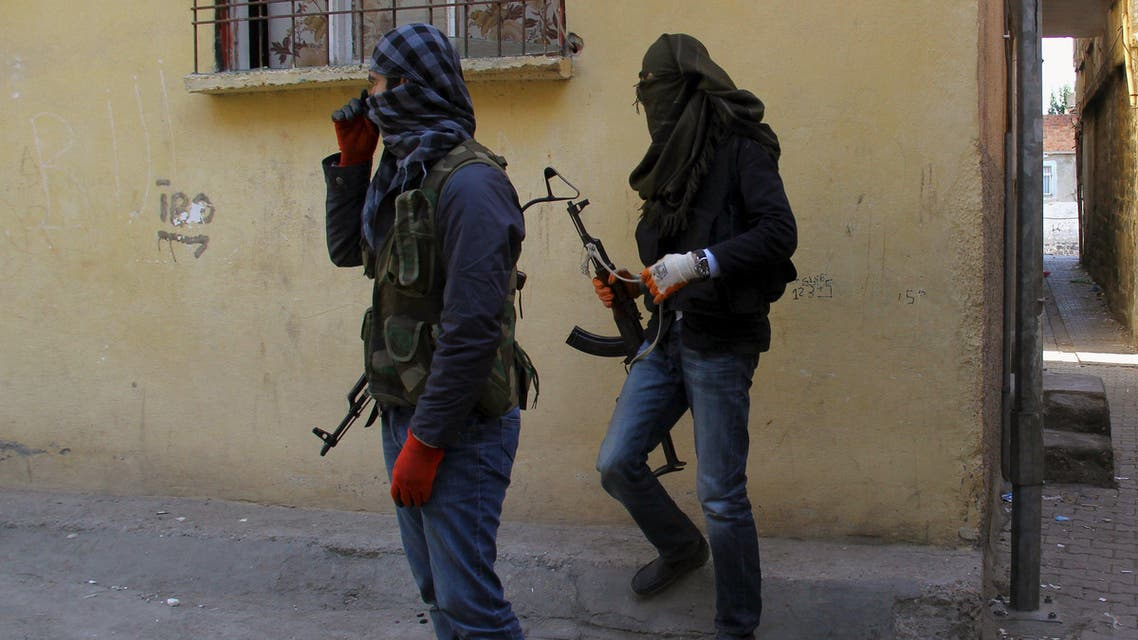 "Masked members of YDG-H, youth wing of the outlawed Kurdistan Workers Party (PKK), stand at a corner in Sur neighbourhood of the southeastern city of Diyarbakir, Turkey, November 6, 2015. Kurdish militants scrapped a month-old ceasefire in Turkey on Thursday, a day after President Tayyip Erdogan vowed to ""liquidate"" them, dashing hopes of any let-up in violence in the wake of a national election. REUTERS/Sertac Kayar"