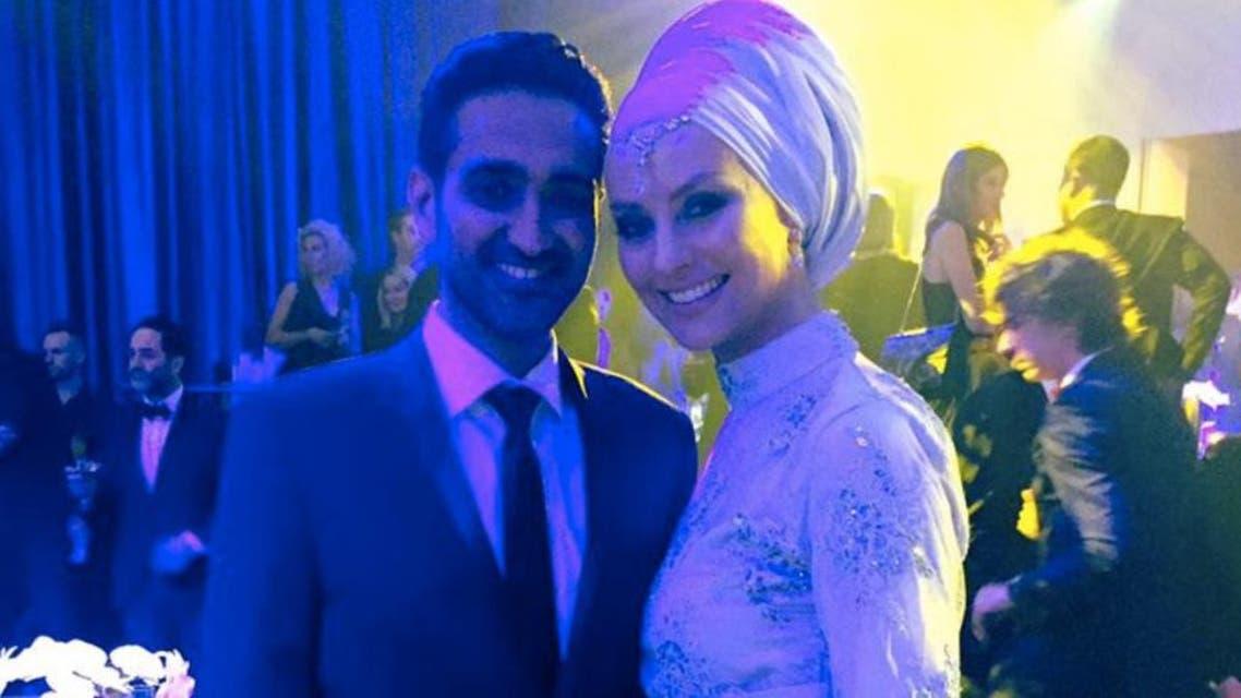 الأكاديمية المسلمة برفقة زوجها المذيع التلفزيوني