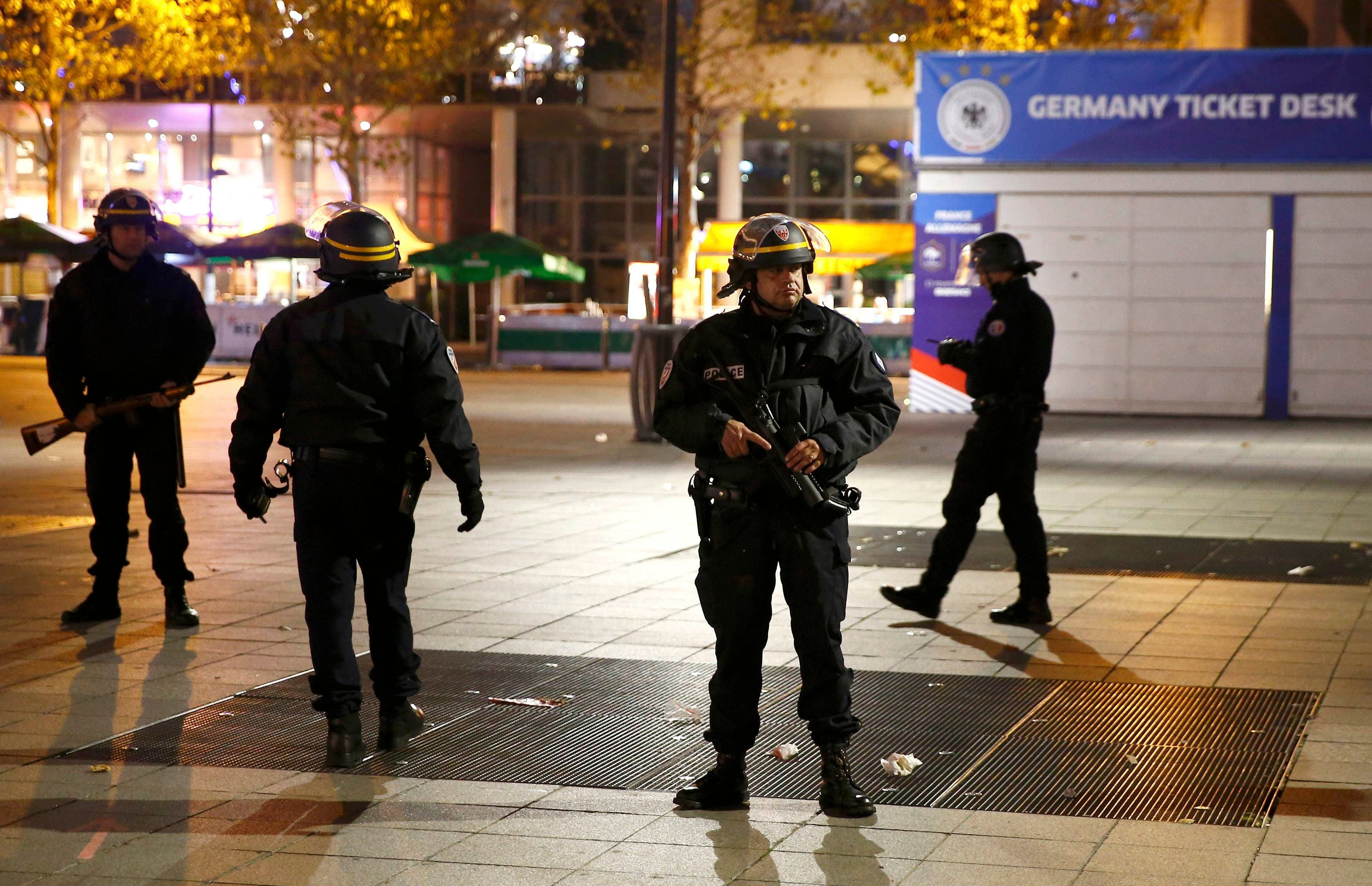 Police stand outside the Stade de France where explosions were reported to have detonated outside the stadium during the France vs German friendly soccer match near Paris, November 13, 2015. (Reuters)