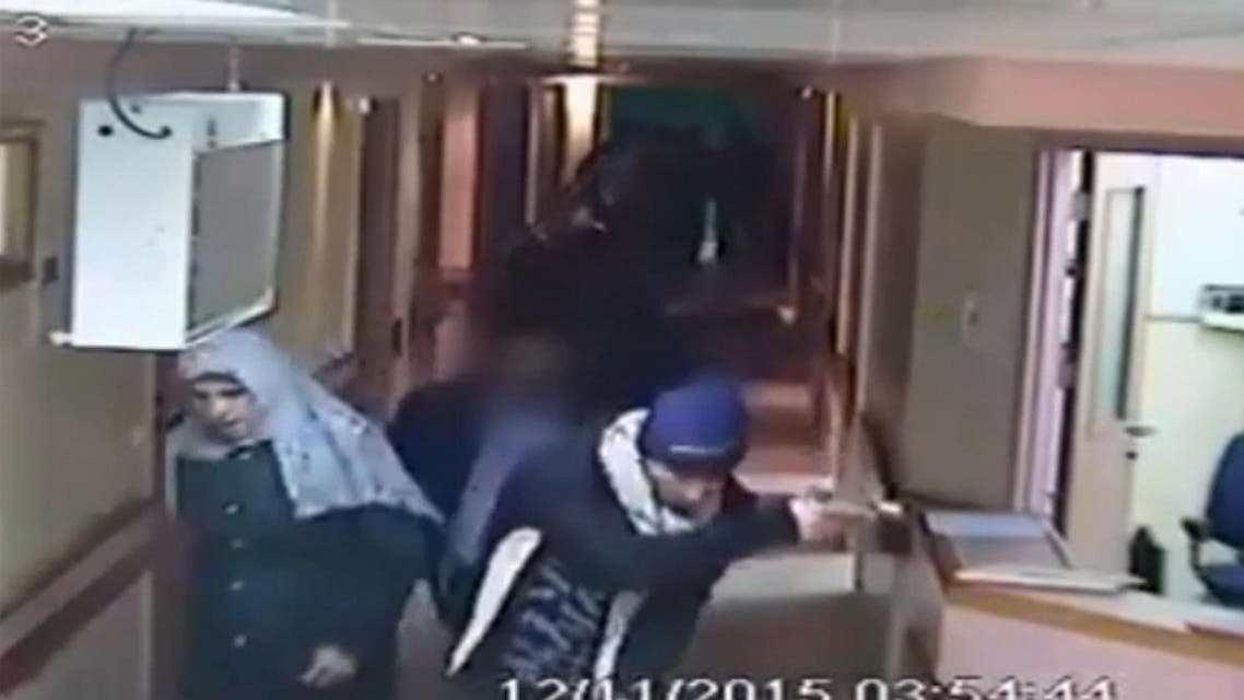 This image made from CCTV video released by Al-Ahli Hospital shows an arrest raid seeking a stabbing suspect by Israeli forces, one disguised as a pregnant Muslim woman, and others disguised in fake beards in Hebron. (AP)