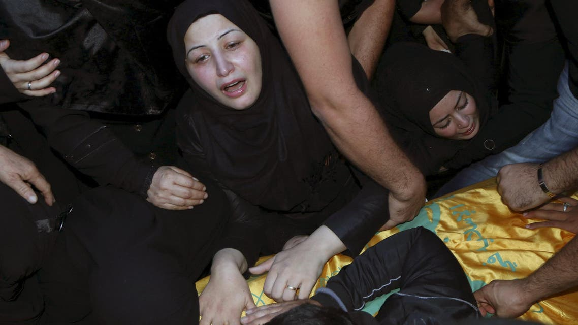 Relatives mourn over the coffin of Hezbollah member, Adel Akram Termos, who was killed in the two explosions that occurred on Thursday in Beirut's southern suburbs, during his funeral in Tallousa village, southern Lebanon November 13, 2015. (AP)