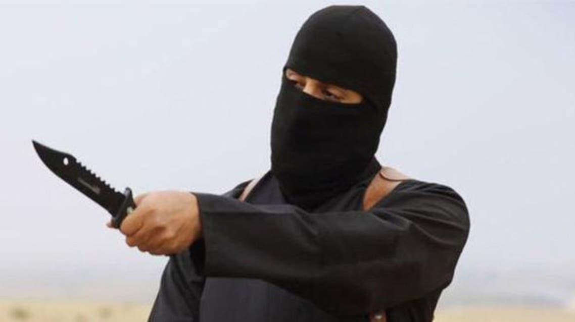 داعش ذبح إرهابي ملثم سكين يقطع رأس يجز